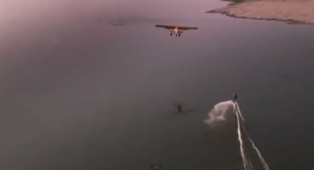 Wakeboarder towed by a plane