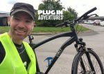 Adventurer races e-bike against electric car and wins
