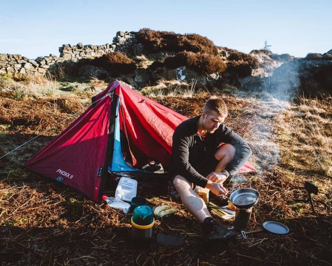 Harrison Ward cooking on Side Pike after a wild camp - Photo by Daniel J Toal